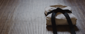 Folded traditional Japanese outfit on the floor of a dojo